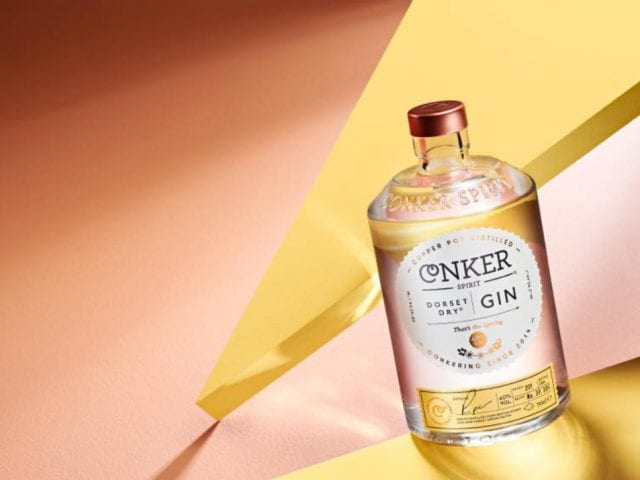 a bottle of conker spirit gin against a yellow background