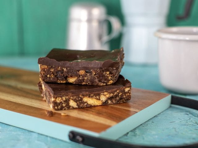 two slices of tiffin on a kitchen worktop