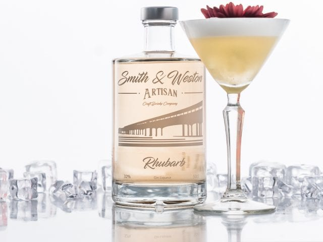 smith and western bottle beside a cocktail