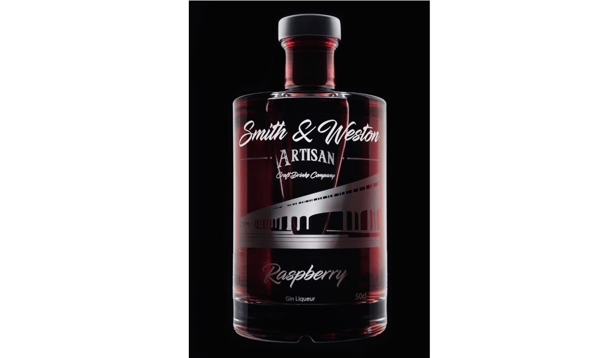 smith and western bottle against a black background