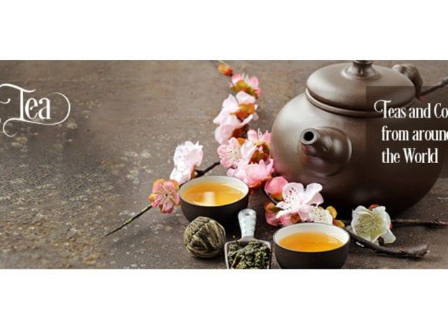 a tea pot with flowers advertising it's tea