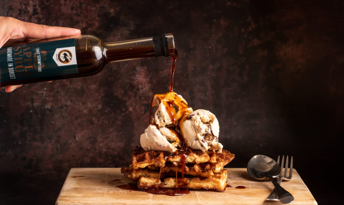 waffles and ice cream with dorset nectar sauce drizzeld over the top
