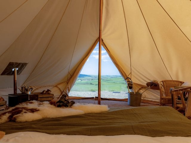 view from the inside of a tent