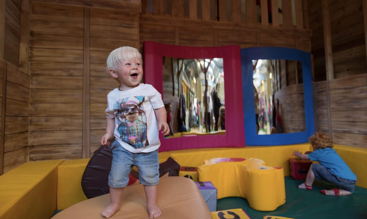 small child enjoying a play area at farmer palmers